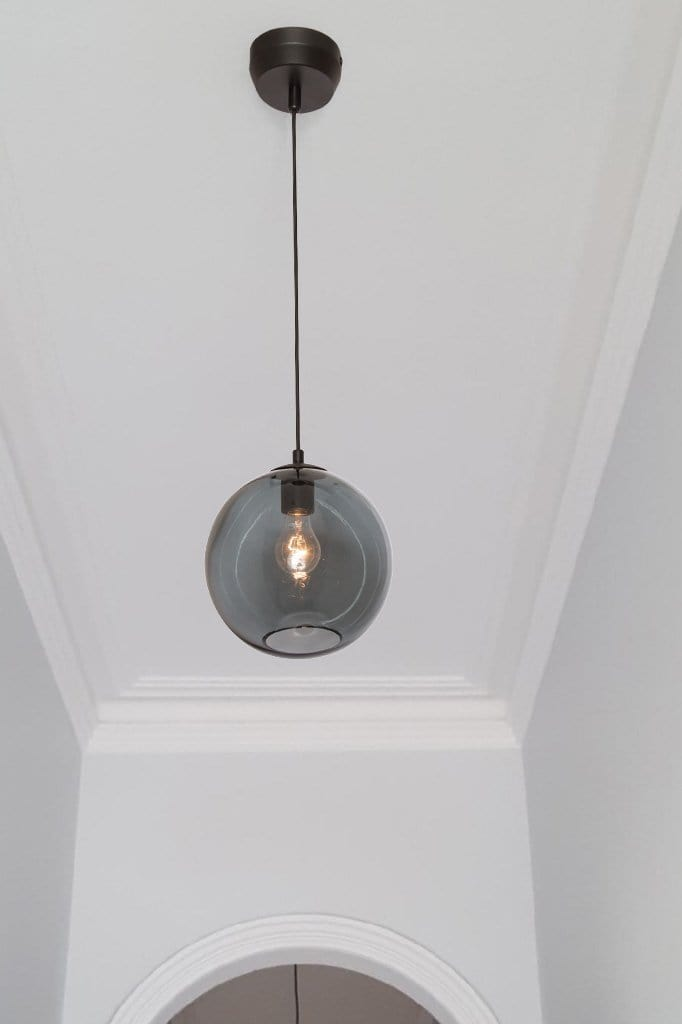 Smoked glass pendant light. luxe lighting for hallway. kitchen glass ball lighting