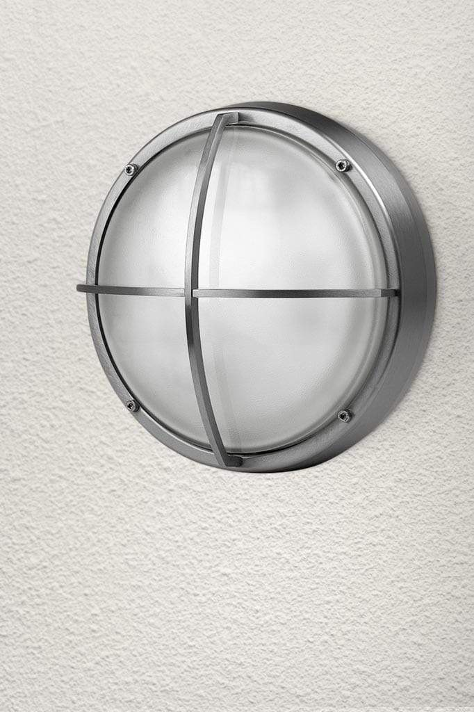Caged stainless steel bunker light with glass lens