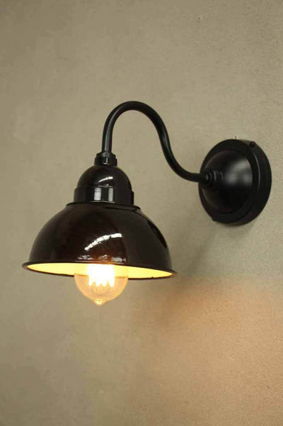 Steel construction of gooseneck sconce shade and cage guard. ip22 rated to use indoor or outdoor.