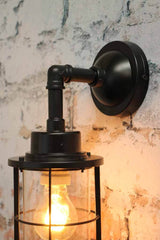 Steel construction of wall sconce and black metalware wall plate