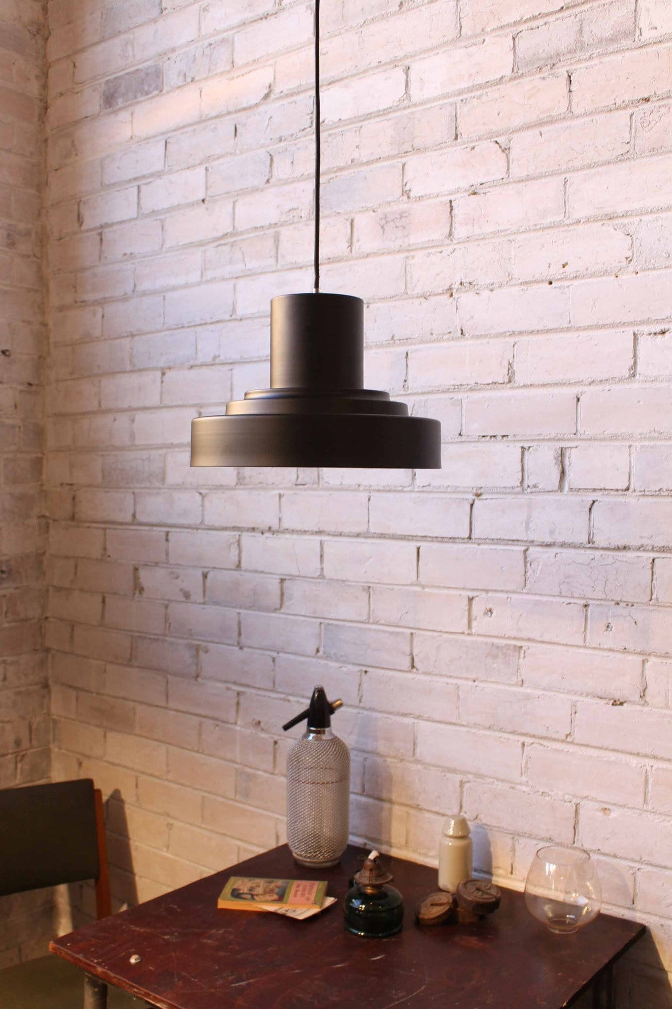 Stepped ceiling light in black metal