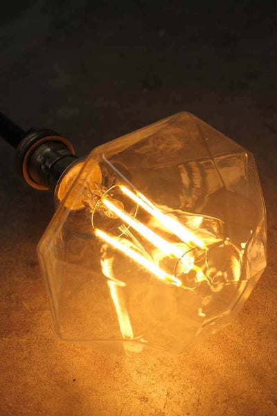 Stylish and decorative led filament bulb. dimmable long led filaments. multi faceted diamond shaped blown glass. looks as good off as it does on