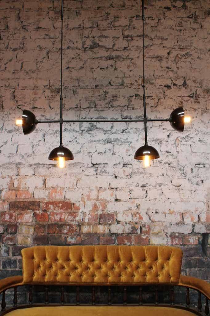 The bakelite bowl junction light is a 4 pendant chandelier with vintage bakelite shades on a quality brass frame