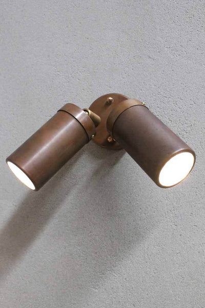 The copper outdoor double spotlight is a wall mountable so you can point individual beams at ornaments or highlights