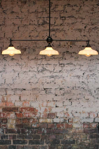 The Mayflower 3 Light Glass Pendant is a great addition to any mondern classic decor