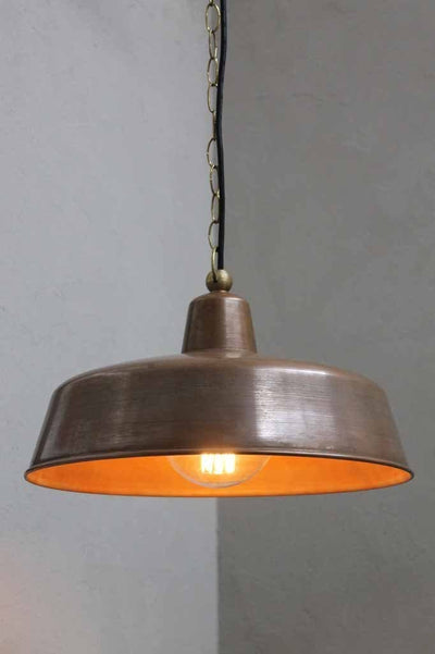 The outdoor copper pendant light is an aged copper shade pendant with a quality brass base and fittings