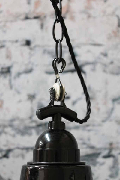 The high top chain and pulley suspension design of this light make this black pendant light a feature over a kitchen island or as a kitchen centerpiece