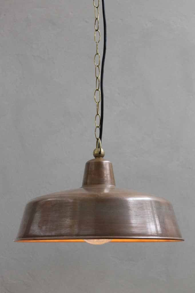 The outdoor copper pendant light has brass chain and black pvc cord