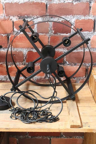 The steampunk drum light comes in a small four bulb holder ideal over kitchen islands.