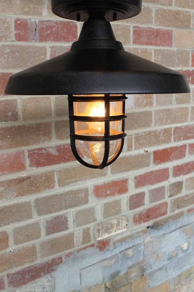 This wharf outdoor flush mount light is a truly versatile outdoor ceiling light that is sure to please the crowd.