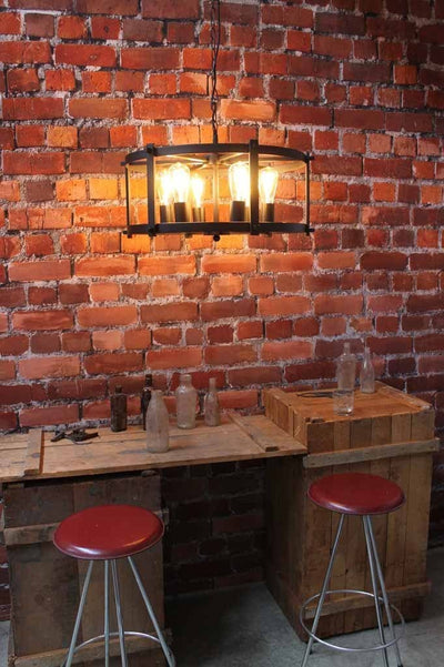 This steampunk drum light has strong industrial design. ideal for completing a home bar decor.