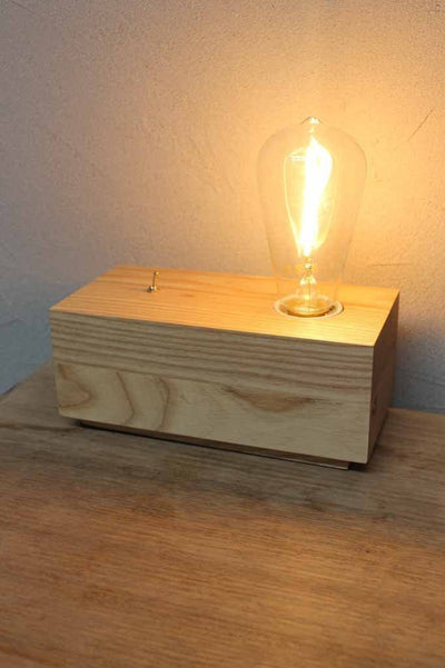 This timber table lamp has a modern natural feel and would suit a wide range of interiors. online lighting. lamps online timber desk lamp  . buy online