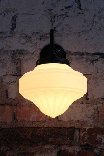 This wall light comes in two sizes and attaches to a gooseneck sconce to mark hallway halls offices or cafe fitouts with a homely elegance