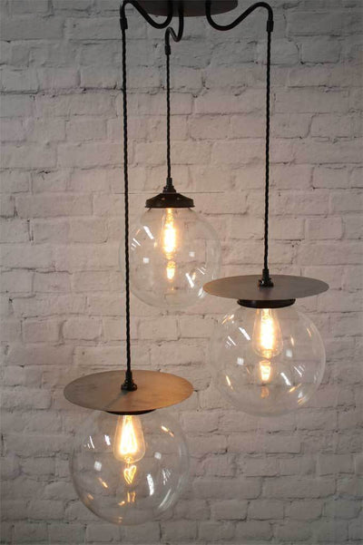 Trio of medium and large clear glass pendants and metal dics with gooseneck style and woven cord suspension