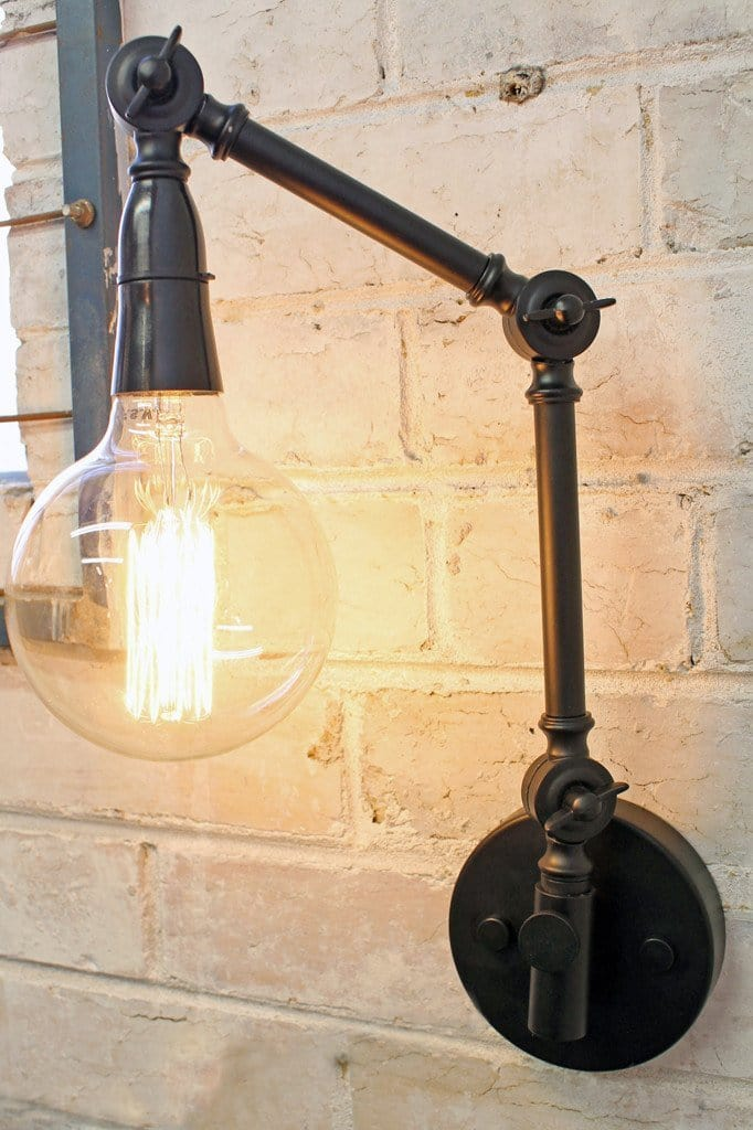 Two arm swing wall lamp has industrial styling