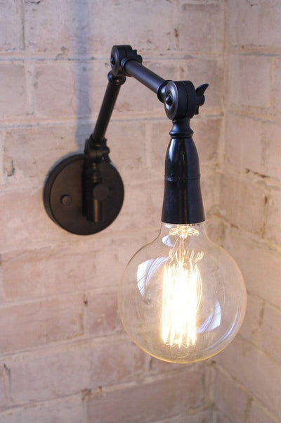 Two arm swing wall lamp with x large edison bulb