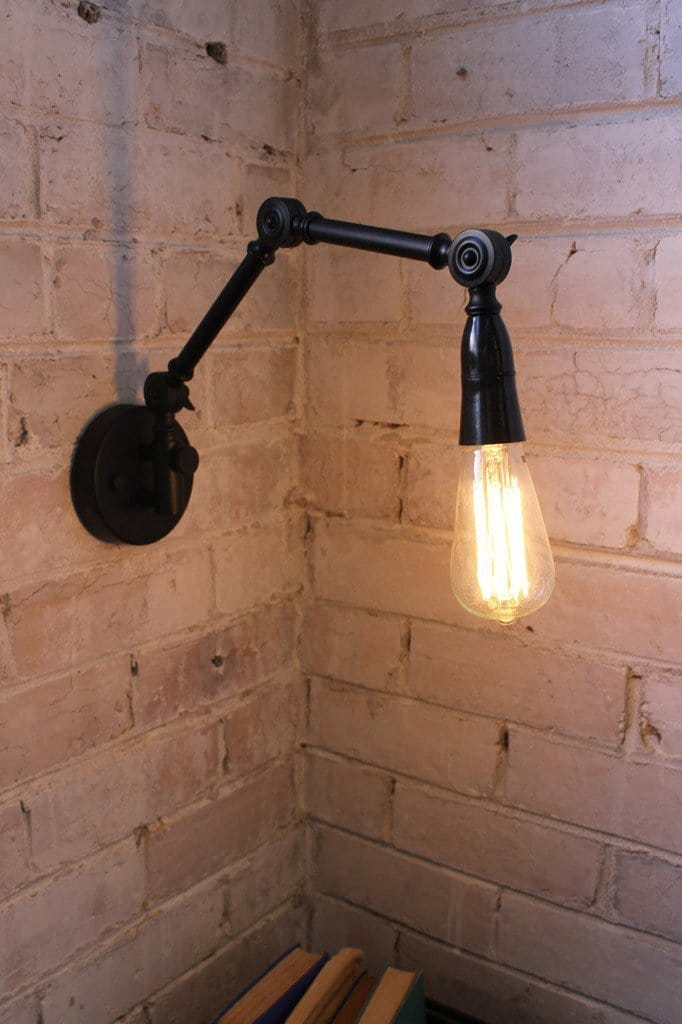 Two arm swing wall lamp with teardrop edison bulb