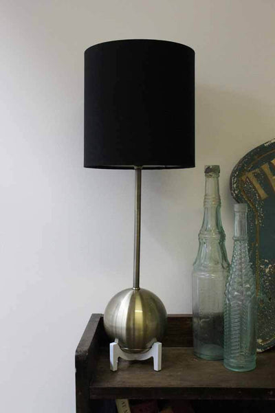 Unique mid century modern table lamp. luxe decor items. black fabric shade.