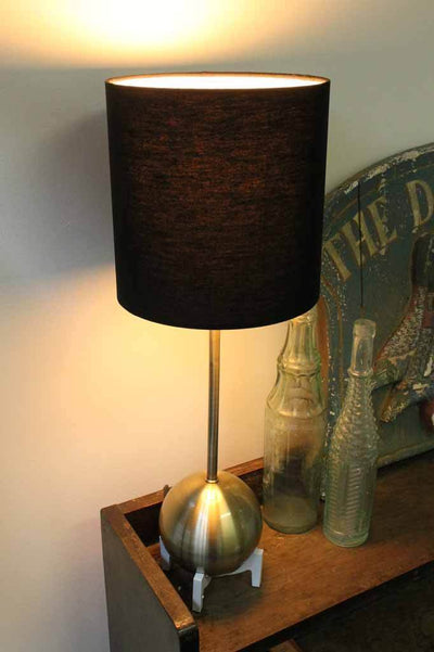 Unique mid century modern table lamp. Luxe polished brushed brass ball base with thin stem. Black fabric shade. Suits any setting including bedside table hallway table