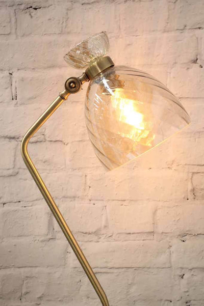 Vannes gold floor lamp with hourglass shade and brass metalware