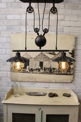 Vintage Industrial Double Arm Pulley Light has an antique bronze finish 132ceec0-b818-4135-b39e-9b6e7cebb6ac