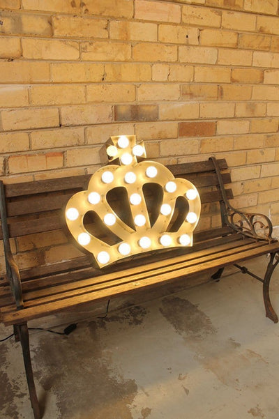 Vintage marquee light crown on chair