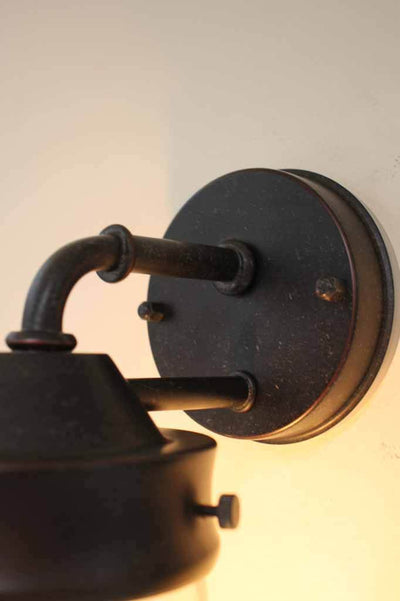 Wall light is made from solid cast aluminium with an antique bronze