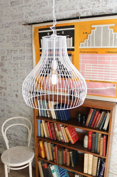Wire cage pendant light in vintage retro setting