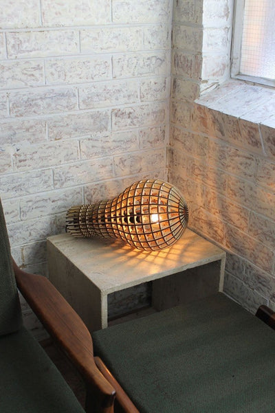 Wooden bulb light on side table