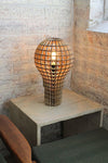 Wooden bulb table light in lounge room