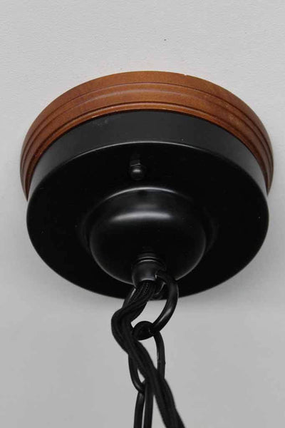 Wooden mounting block on black metal ceiling rose with chain for enamel lights
