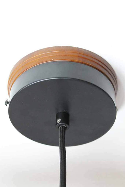 Wooden mounting block with black metal ceiling rose and black pendant cord.
