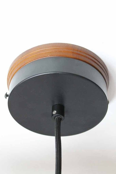 Wooden mounting block with black metal ceiling rose and black pendant cord