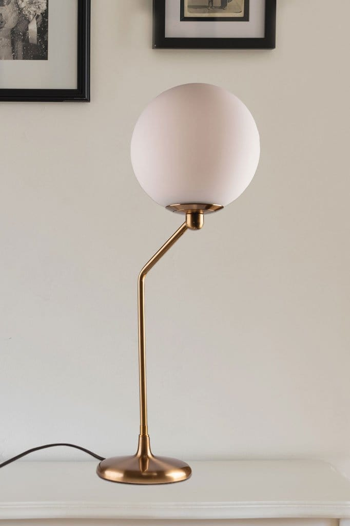 Art deco inspirated table lamp with aged brass metalware and frosted shade vintage lighting