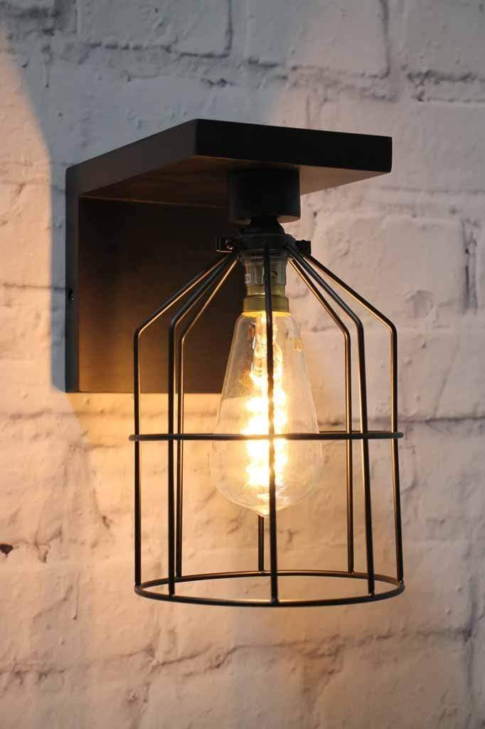 Black on black cage wall light with exposed bulb