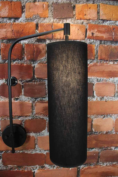 Black long frabric shade on black wall sconce