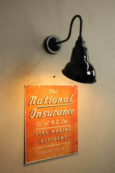 Black wall sign light versatile for both outdoor and indoor use.
