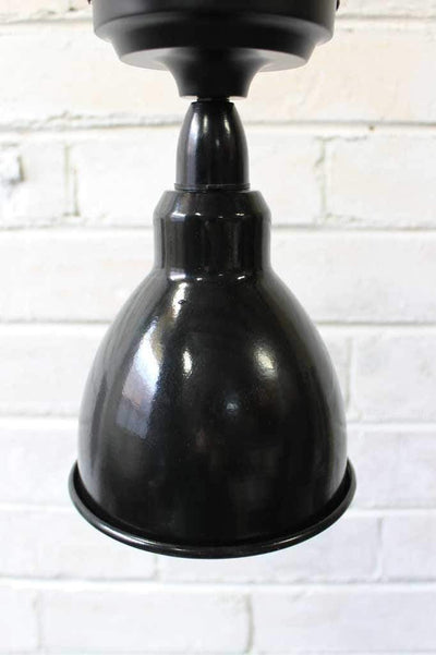 Brasserie batten lights are french inspired in black enamel and ideal ideal in open living spaces as well as any room with lower ceilings.