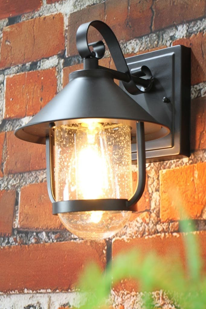 Clear glass black steel exterior wall light