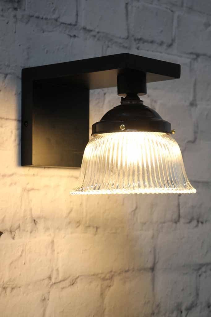 Clear glass on bell shaped glass shade classic vintage design on matt black wooden wall sconce