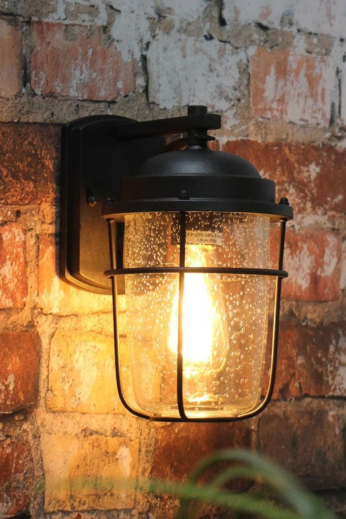 Small black steel outdoor wall light for front porch