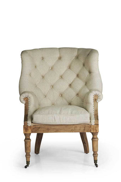 Front on shot french provincial wingback fabric armchair classic weave hand nailed exposed hardwood frame