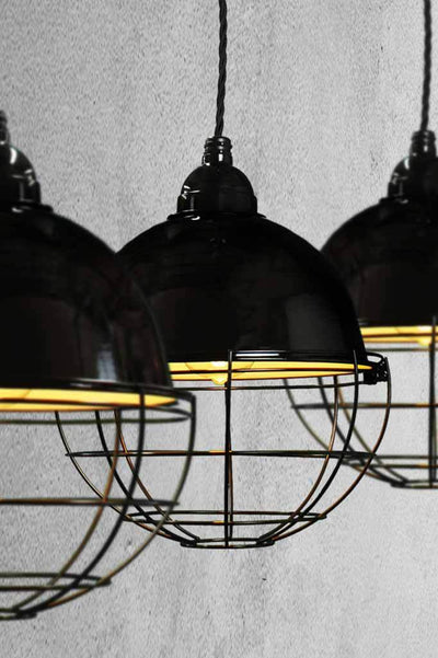 Glossy black porcelain enamel shades feature a steel cage.