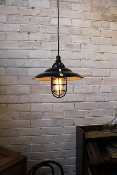 Industrial bunker pendant light used as cafe lighting in cafe interior
