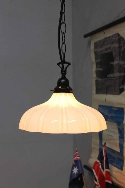 Mayflower glass pendant light on chian cord suspension. glossed opal glass shades come in both small and large sizes.
