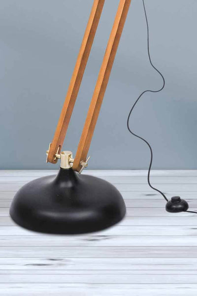 Metal base on floor lamp with foot on off switch