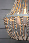 Natural white wooden beading with exposed bulbs on a  pendant light