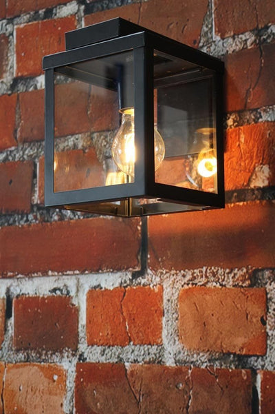 Outdoor porch light with black steel frame and glass panels