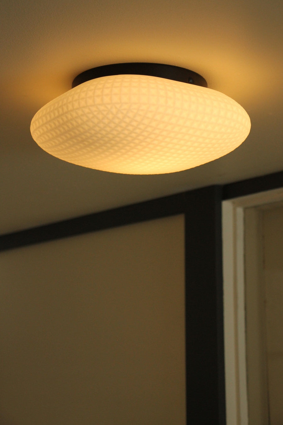 Oyster style ceiling light is the perfect fitting for an ensuite bathroom or powder room