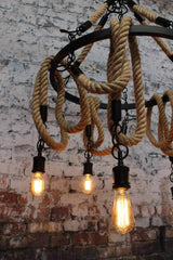 rope chandelier Made of metal the large circular ring holds five rope pendants